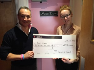 Hostel manager, Orla presents me with a cheque outside the Margot Room