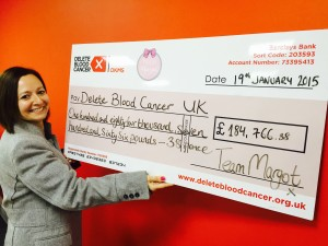 Margot's auntie Nadia with cheque for Delete Blood Cancer UK