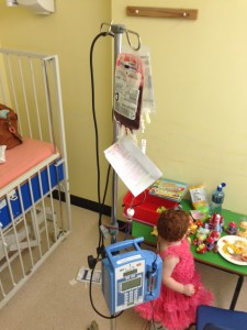 Margot receiving a red cell transfusion as a day patient - at the time, we were caring for her at home