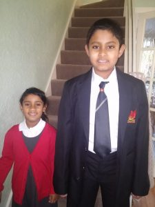 Back to school: Kenu with his sister, Ashi