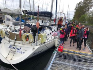 Team Margot Rowers next to our support boat, Mistral and support crew