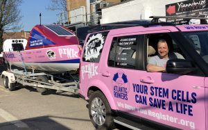 Thinking pink: Marfgot's father, Yaser with the Team Margot Atlantic Rowers' car and boat, which will be going 3,000 miles across the Atlantic to encourage people to register as stem cell and bone marrow donors